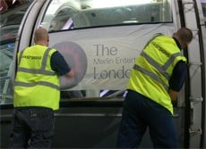 Local signage company works FAST all night to re-brand London Eye
