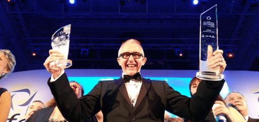 Lee Eaton holding award