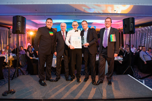 Franchisee Lee Eaton of Signs Express Manchester, accepting his Franchisee of the Year award from the directors.jpg