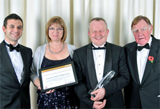 Franchise of the Year winners Ruth Dawe and Laurence Fitch with sponsors EDF (lt) Energy and Sir Bernard Ingham (rt)