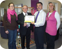 Laurence Bagley from Recognition Express presents Sim Shalom, Sales Director for Listawood with their Supplier of the Year Award 2009. From left to right: Becky Raisbury (Account Manager), Laurence Bagley (Recognition Express), Sim Shalom (Sales Director) and Mel Walker (Customer Service Manager).