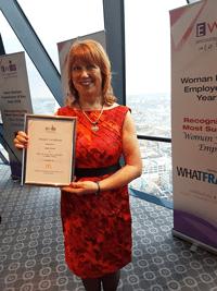 Woman holding award