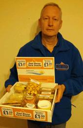 Man holding box of Oast House Farm Snacks